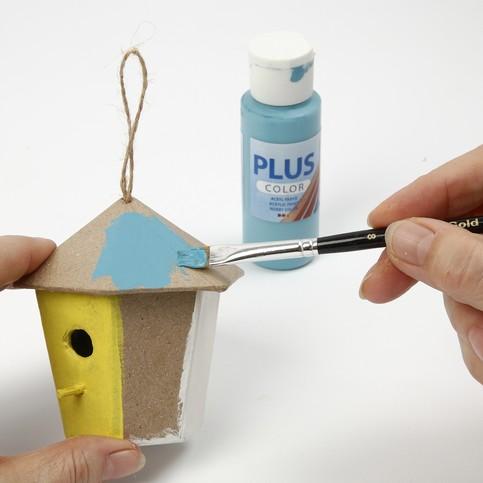 Décorer des supports en papier maché pour enfant